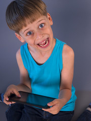 boy playing games on tablet