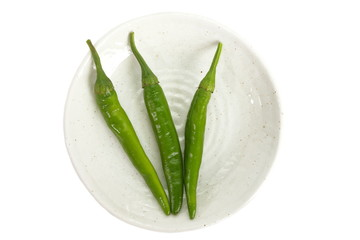 Fresh green chili isolated on a white