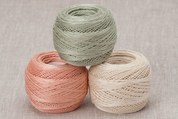 Thread Spools On Natural Linen Background