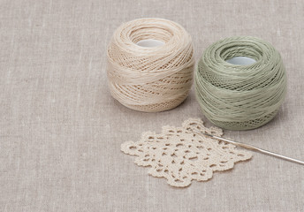 Crochet Lace And Threads. Natural Linen Background