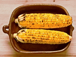 rustic golden grilled corncob