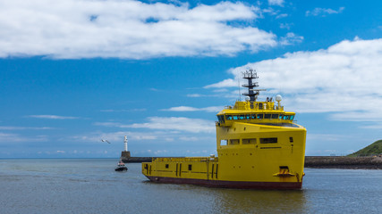 Yellow Platform Supply Ship and Pilot