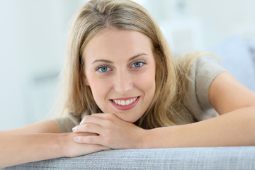 Portrait of beautiful blond woman relaxing in sofa