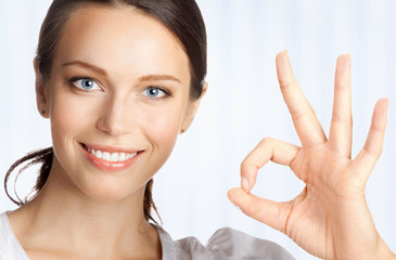 Business woman with okay gesture, at office