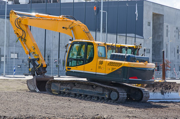 Excavator and bulldozer on construction site.