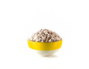 cooked brown rice in yellow ceramic bowl