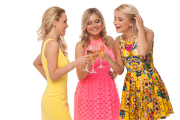 beautiful girls in fashion dresses with champagne