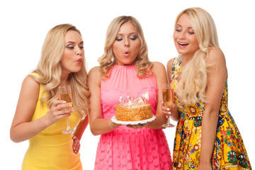 three blonde girls celebration birthday with cake and champagne
