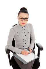 businesswoman sitting in the office chair and siging documents