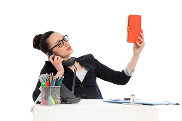 businesswoman  holding notebook, talking on the phone