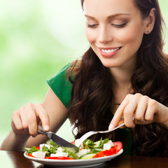 Young woman with salad, outdoor