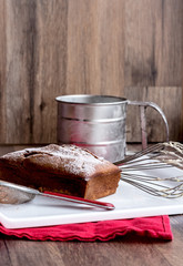 chocolate cake, whisk, steel cup, strainer