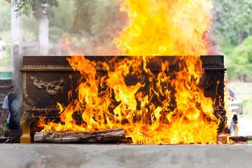 cremation at graveyard in thailand, coffin burning.