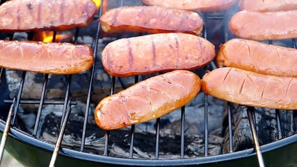 Grilling sausages on a grill