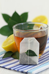 Tea bag, tea and fresh lemon