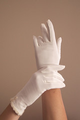 woman modeling vintage white gloves