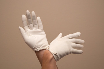 woman modeling formal vintage gloves with small buckles