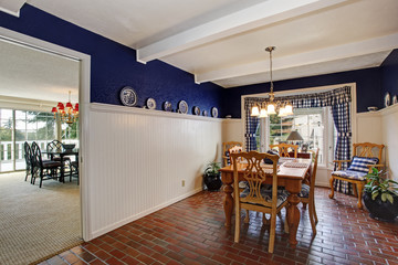 Dining room inteiror with brick floor and royal wall