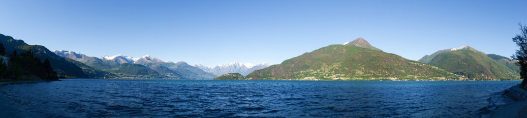 Panorama of the Lake of Como from the Beach at evening sunlight
