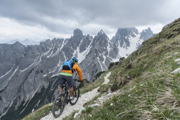 mountainbike downhill with dolomites background