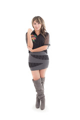 latin girl in grey black dress and long boots