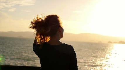 Lonely Woman Looking at the Sunset from the Ship. Slow Motion.