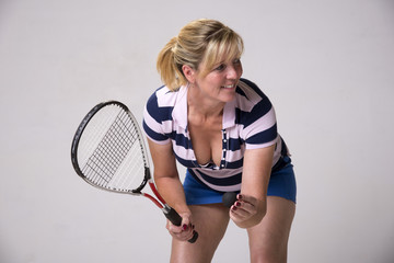 Female squash player in blue and white outfit