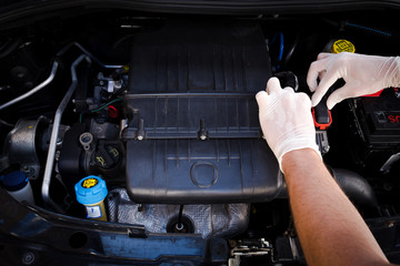 mechanic checks auto electronic control unit, ecu