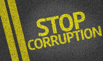 Stop Corruption written on the road