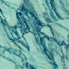 Marble surface in turquoise colors in the background