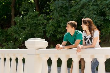 Young couple leaning on a bridge parapet