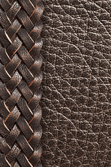 Brown leather with braided leather belt in the background