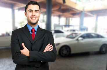 Salesman in a car showroom