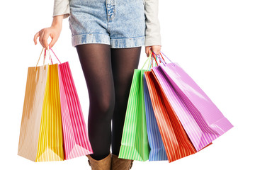 picture of woman's long legs with shopping bags