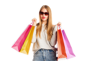 Excited shopping woman isolated on white