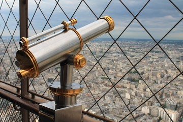 Vintage brass telescope overlooking Paris
