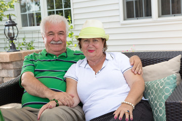 Loving elderly couple relaxing on an outdoor patio