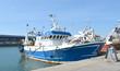Leinwanddruck Bild - Vieux chalutier amarré sur le quai du port de Boulogne sur Mer
