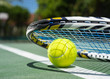 canvas print picture - Close up view of tennis racket and balls on  tennis court