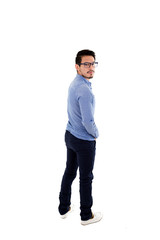 young hispanic man with blue shirt and glasses posing
