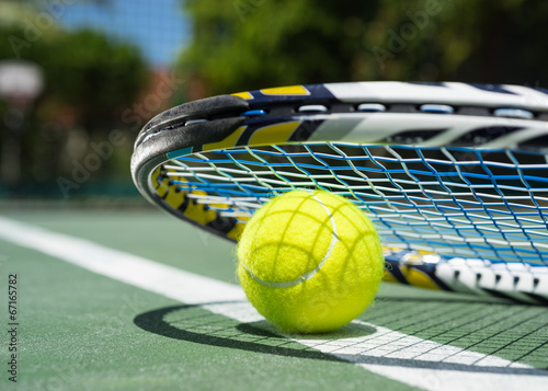 canvas print picture Close up view of tennis racket and balls on  tennis court
