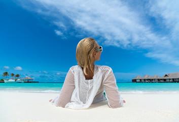 Hot beautiful woman enjoying looking view of beach ocean