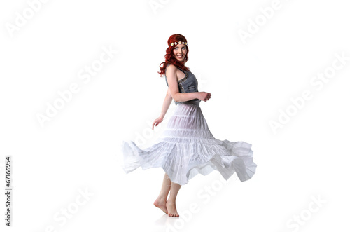 young gypsy woman dancing isolated on white background