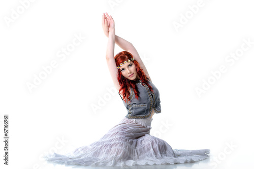 Young belly dancer isolated on white background