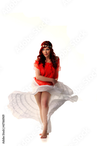 young redhead dancer in ethnic costume
