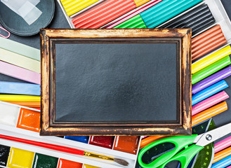 school supplies to the chalkboard