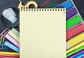 school stationery laid out on the notepad