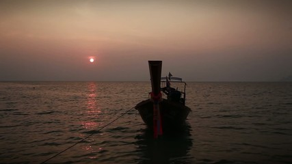 Traditional Thai boat on a sunset