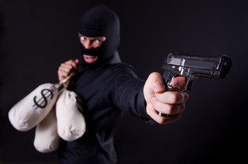 Man wearing balaclava with gun