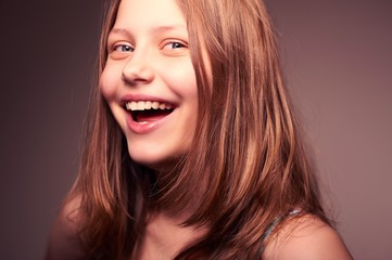 Cute teen girl laughing